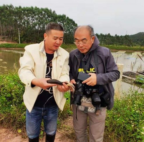 A working group of 'Chinese National Committee for Man and the Biosphere Programme' visited Guangxi Mangrove Research Center and the Field Research Base